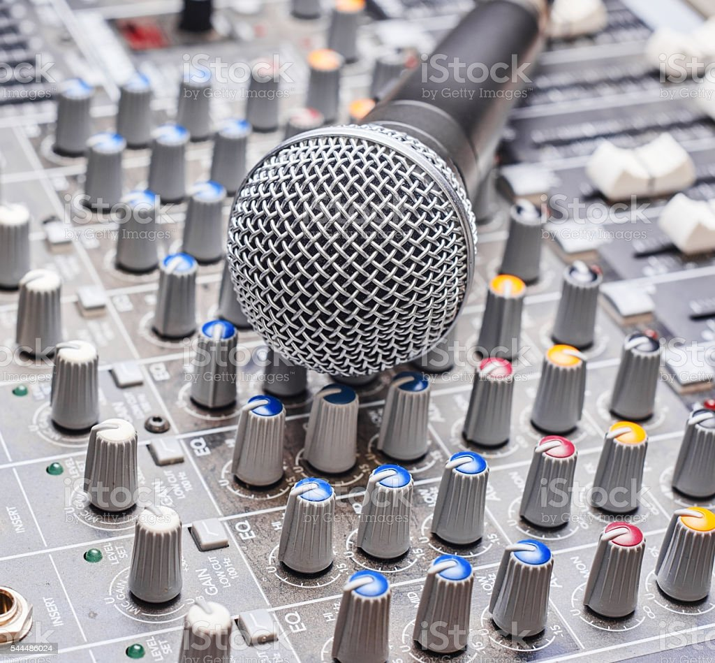 Microphone on sound mixing console stock photo