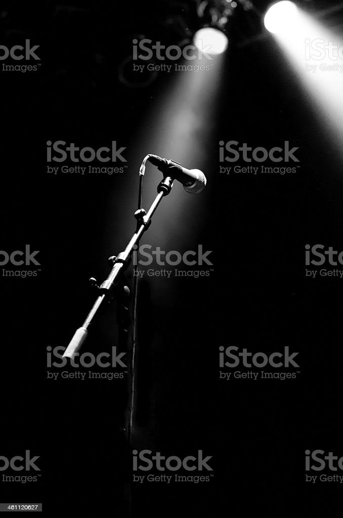 Microphone on stage in black and white, high contrast,music stock photo