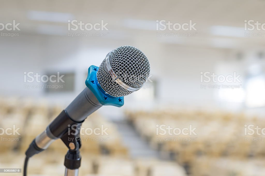 Microphone on stage in lecture hall stock photo