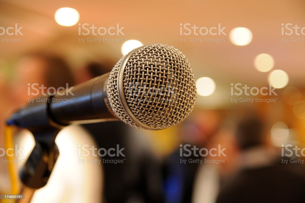 microphone on stage with people at concert royalty-free stock photo