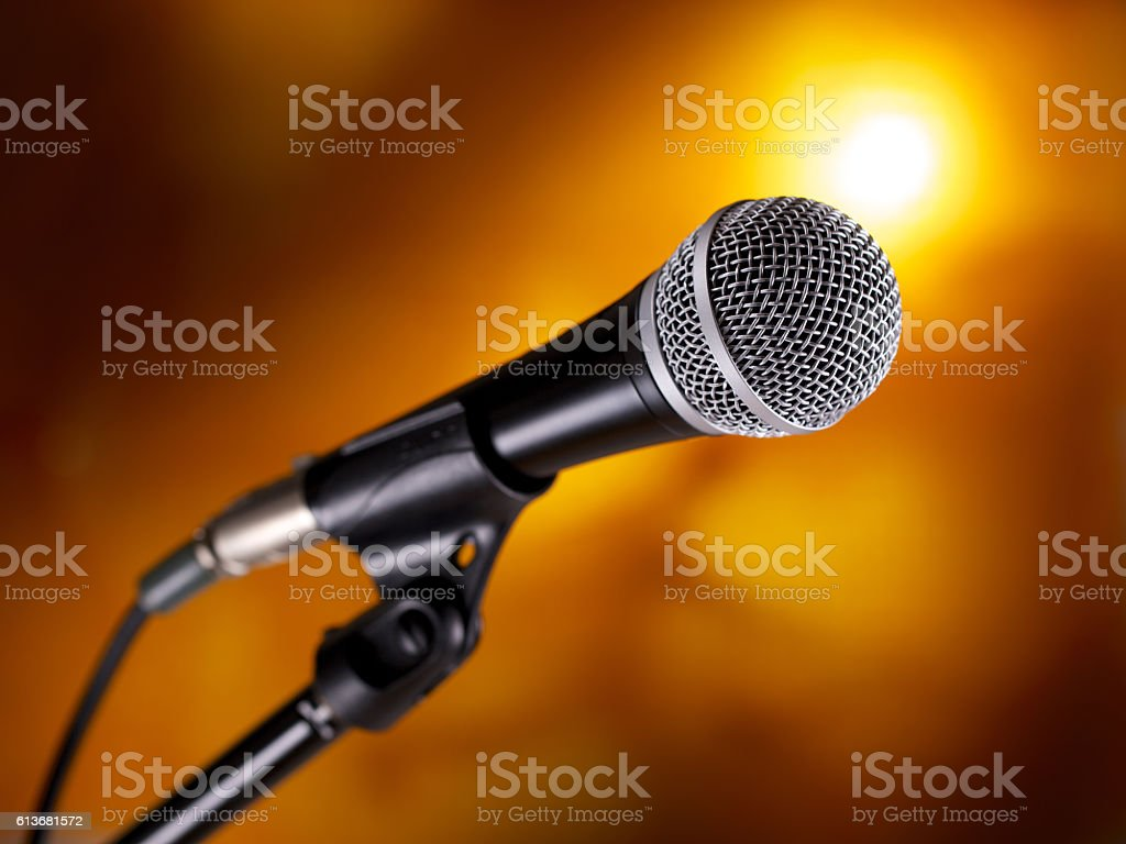 Microphone on stand against a colorful background stock photo