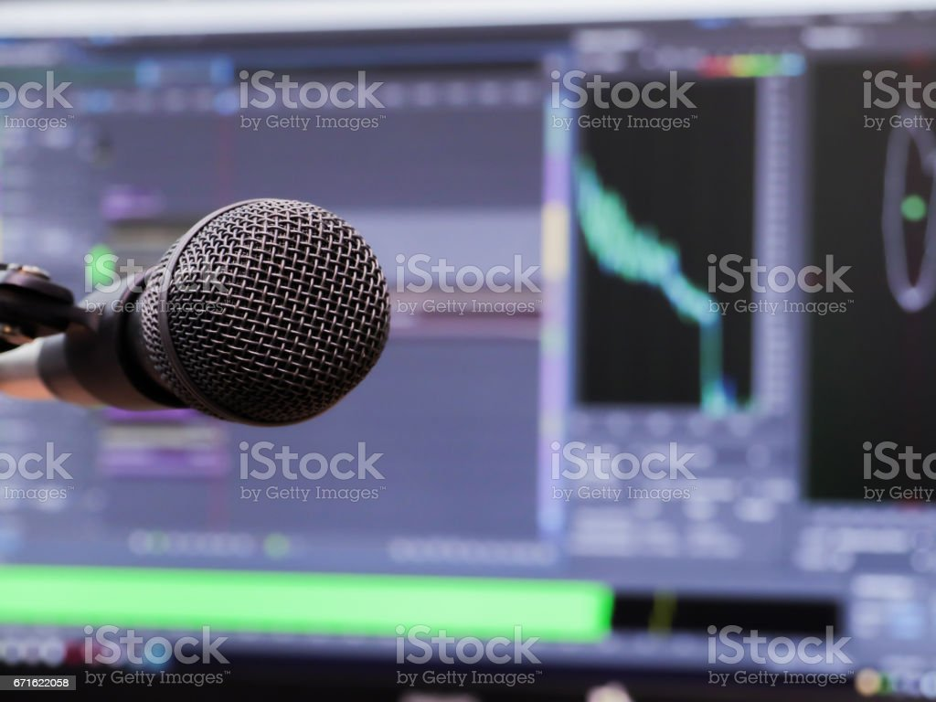 Microphone on the background of the computer monitor. Home recording...