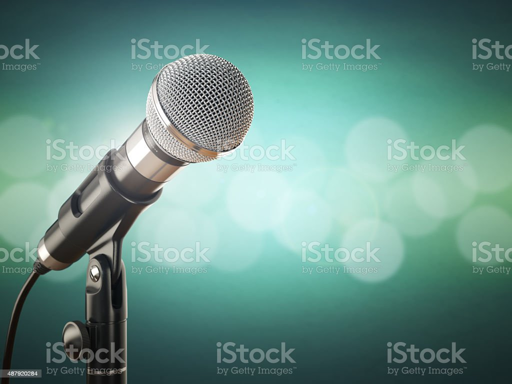 Microphone on the green abstract background. stock photo