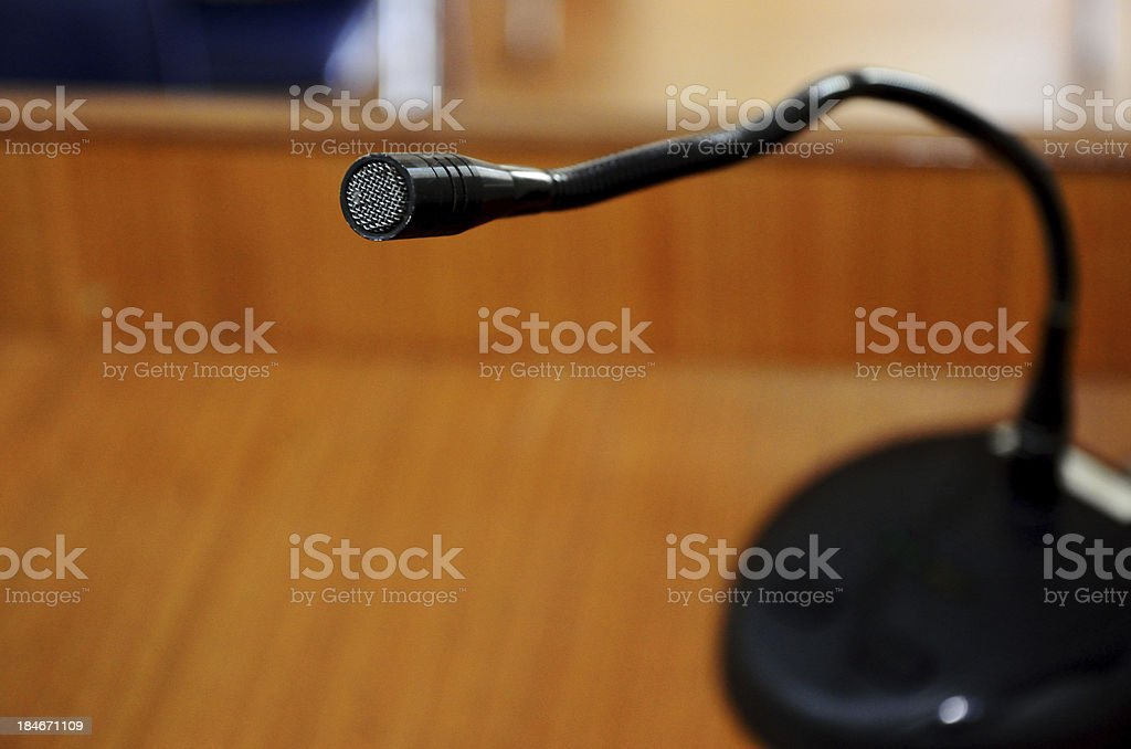 Microphone on wooden podium royalty-free stock photo