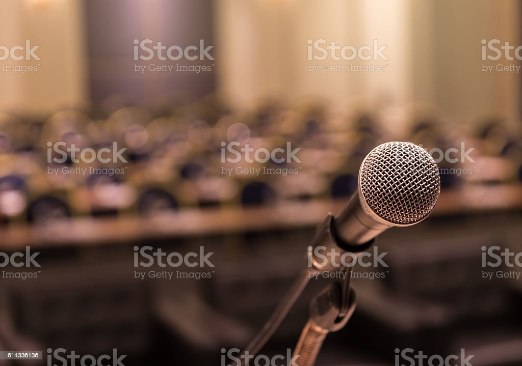 Microphone over the Abstract blurred photo of conference hall stock photo