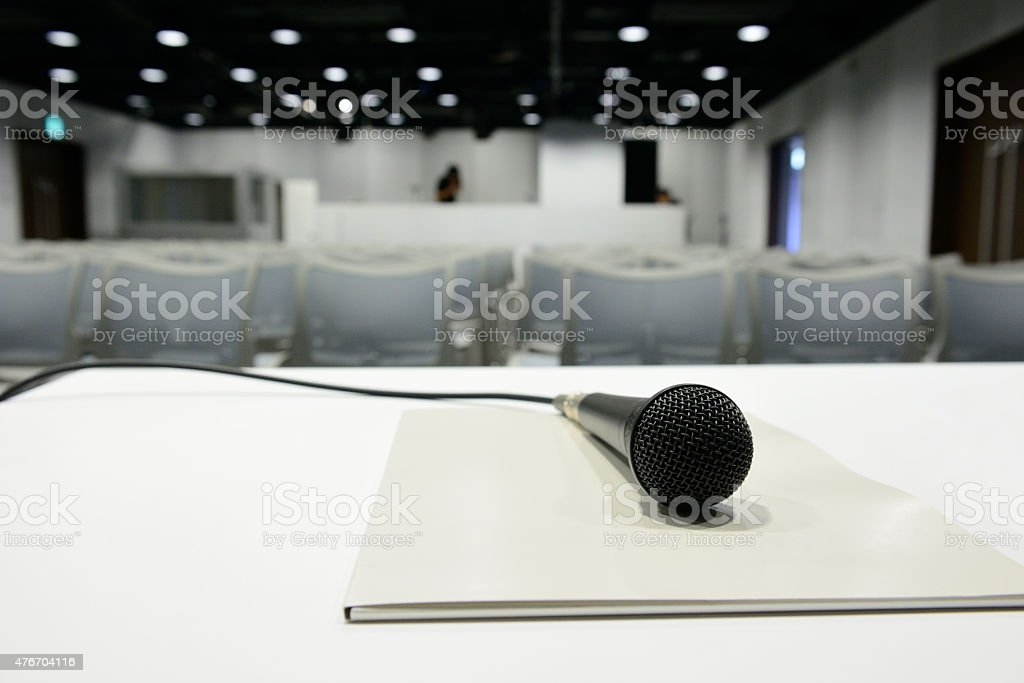 Microphone ready on table, all set for conference to begin stock photo