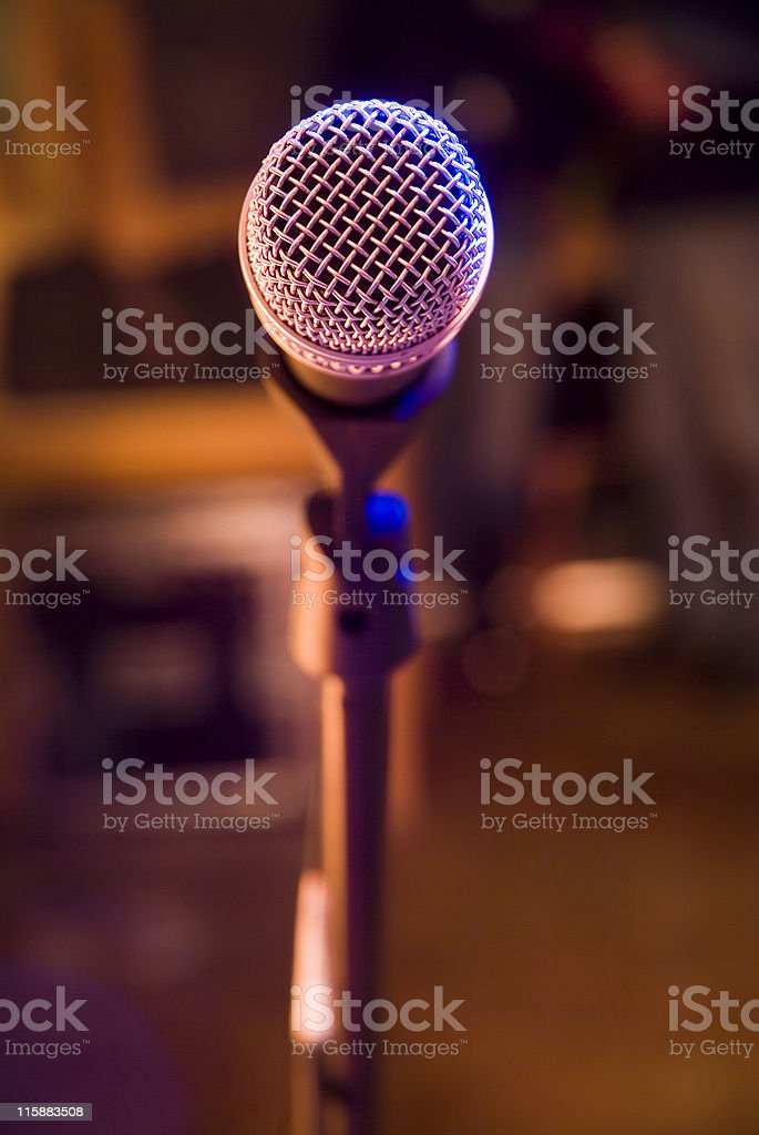 Microphone side lit and from the singers point of view royalty-free stock photo