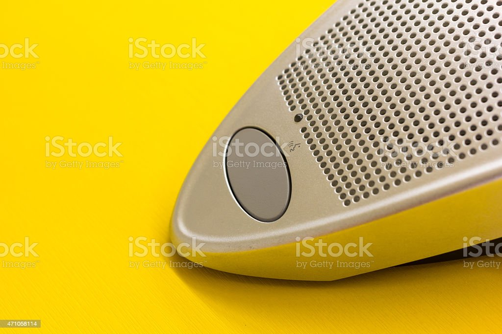 microphone speaker button on the yellow table stock photo