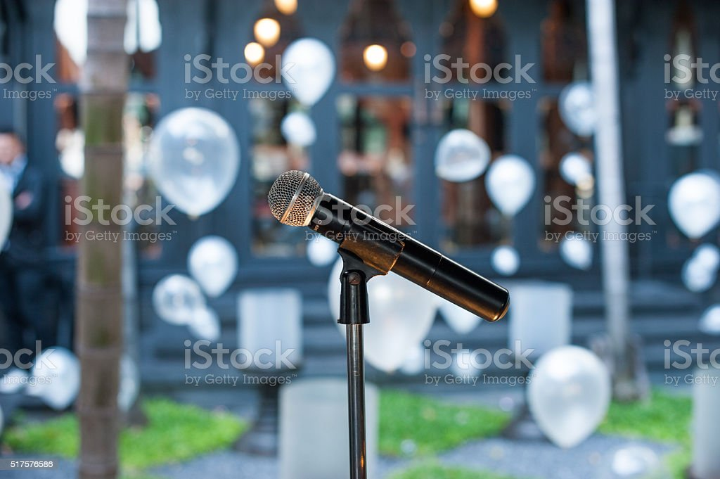 microphone standing and balloons background stock photo
