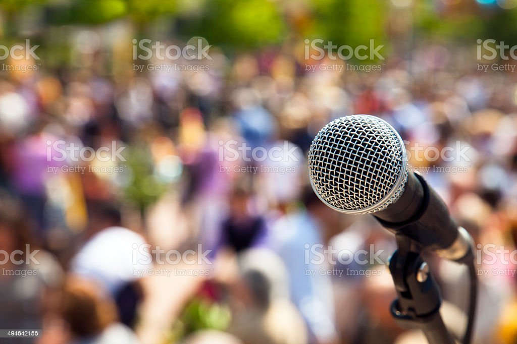 Microphone to the crowd stock photo