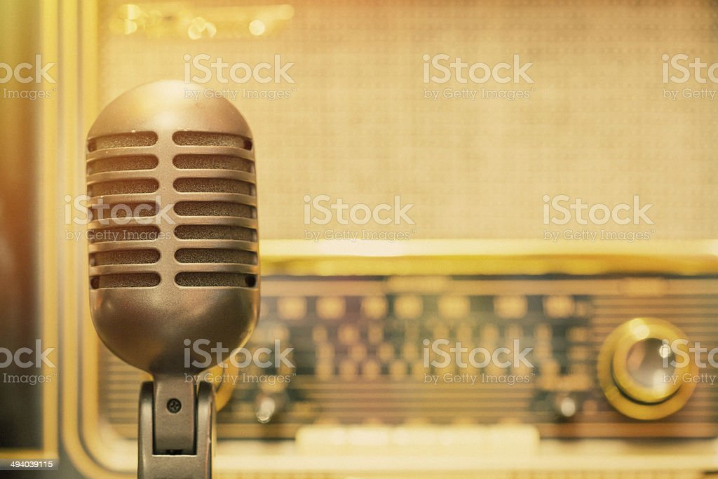 Microphone with an antique radio background stock photo