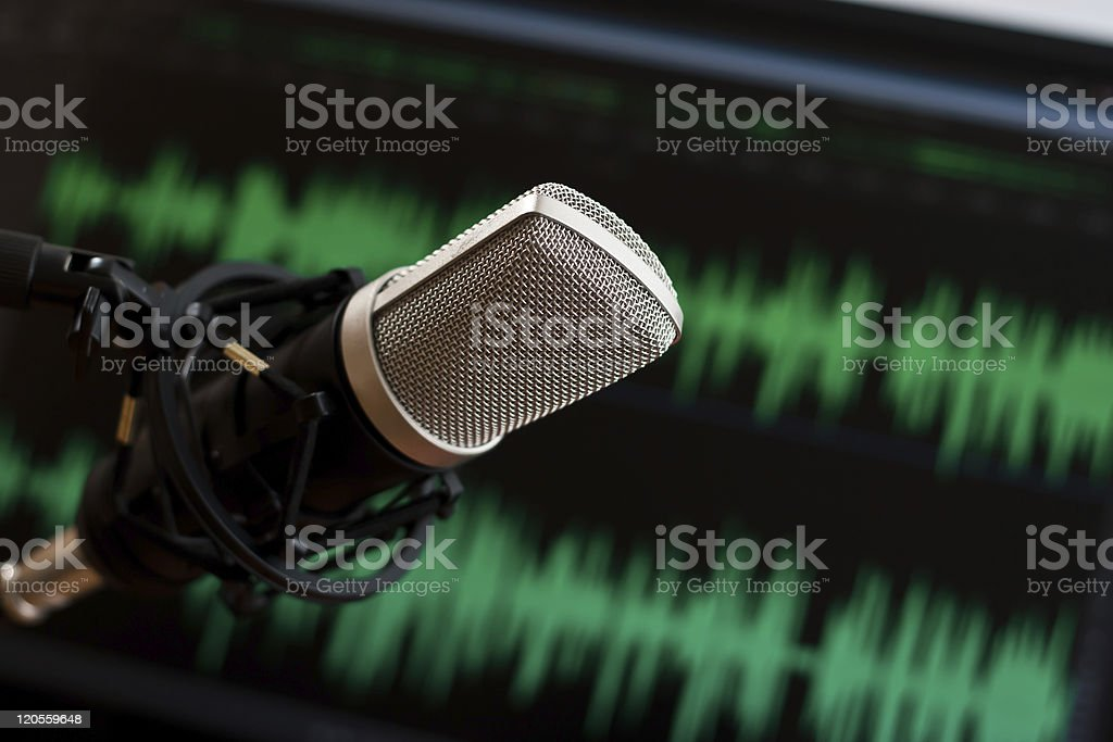 Microphone with audio waveform in the background royalty-free stock photo
