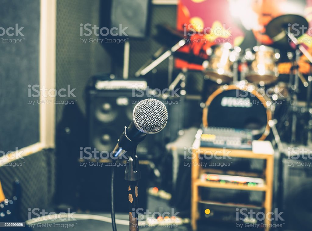 Microphone with blurry music studio backgroun stock photo