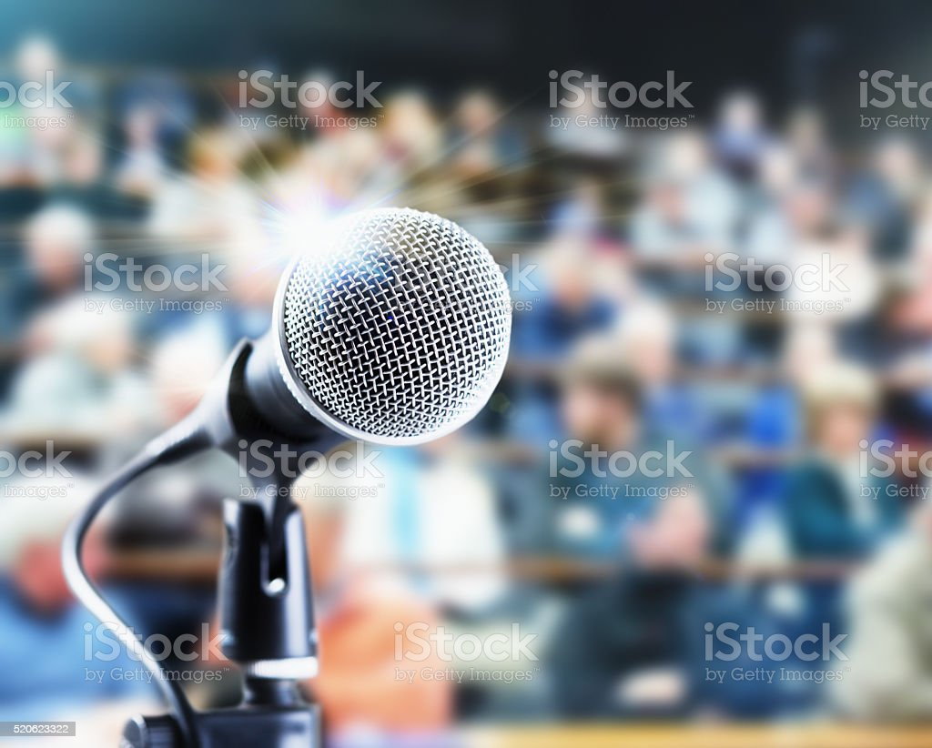 Microphone with defocussed audience waiting for speaker stock photo