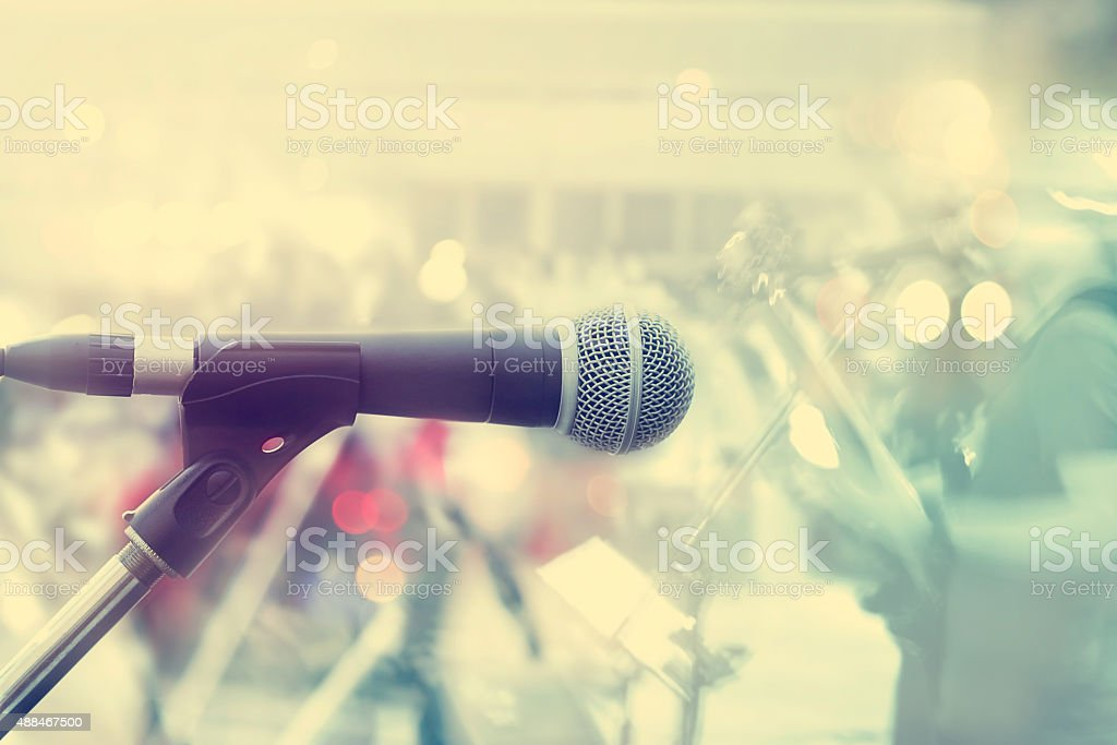 Microphone with guitarist on stage, pastel color and soft stock photo