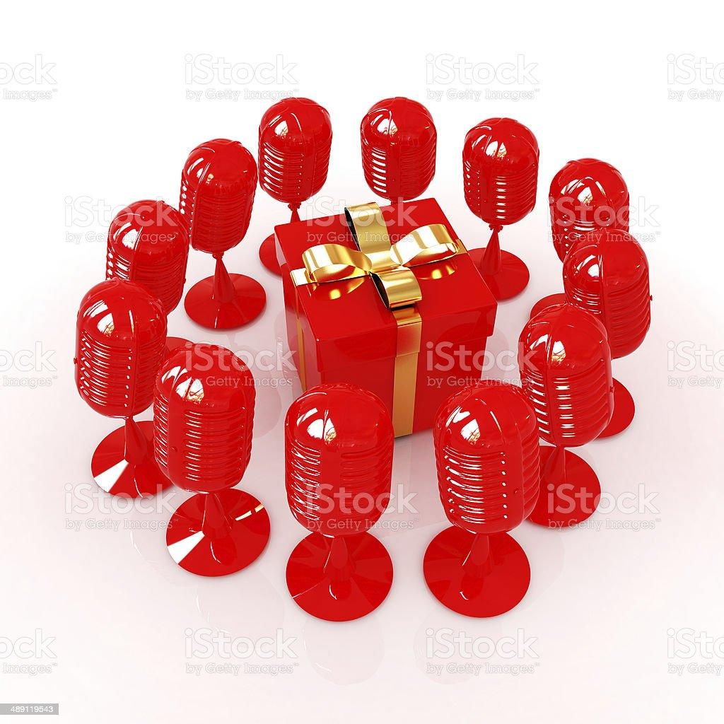 microphones around gift box stock photo