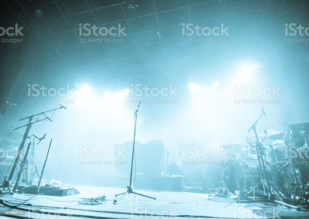 Microphones on empty stage waiting for musicians to come stock photo