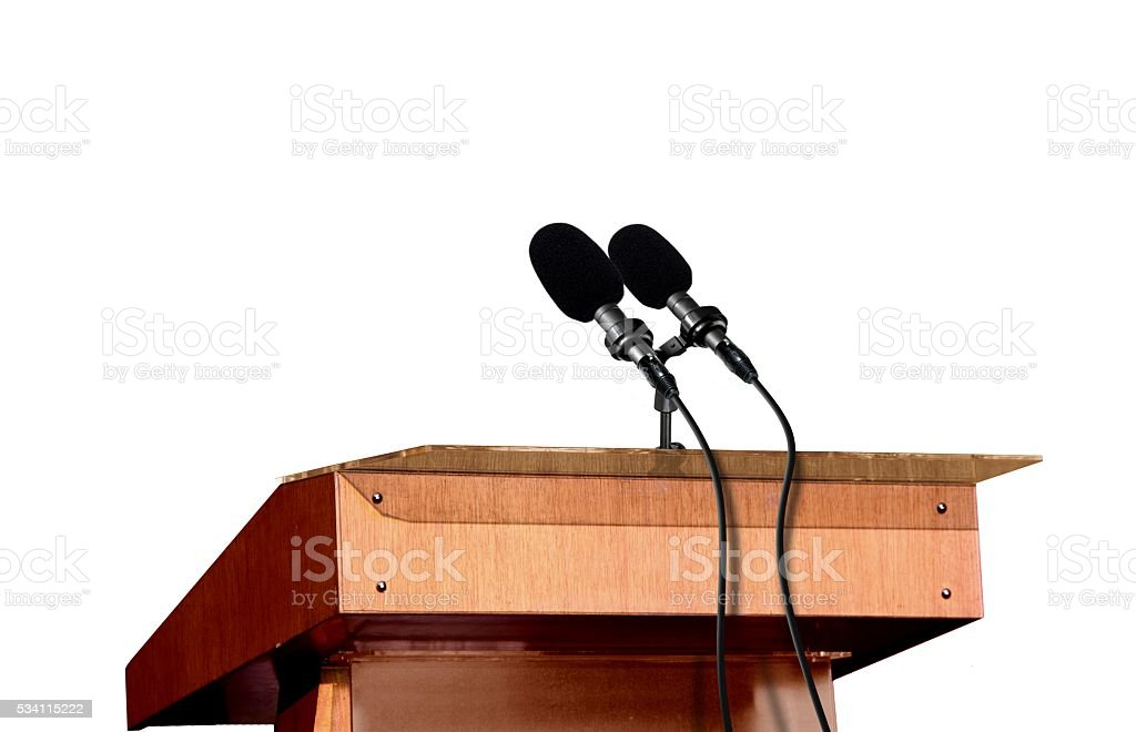 Microphones on the podium over white stock photo