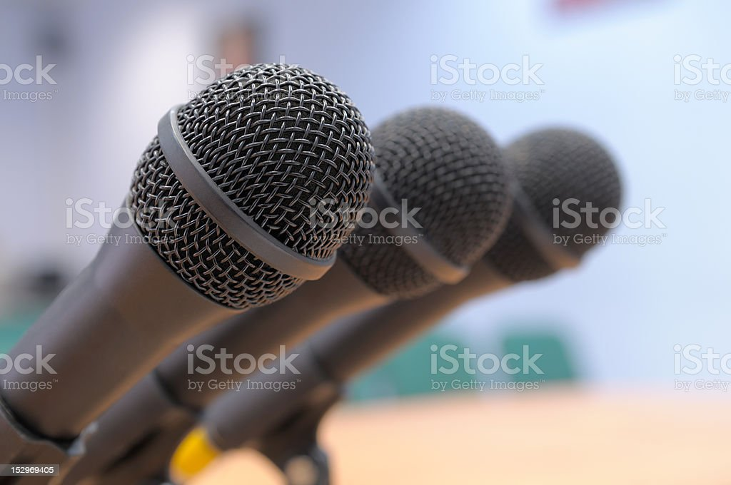Microphones stand at conference hall. stock photo