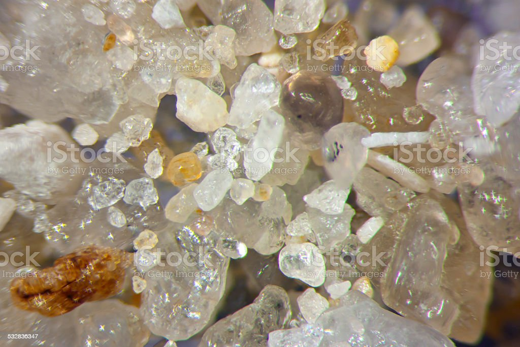 Microphotography of sand grains stock photo