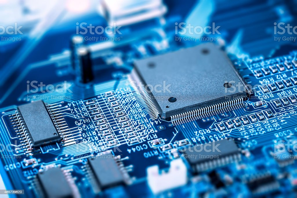 Microprocessor on blue circuit board stock photo