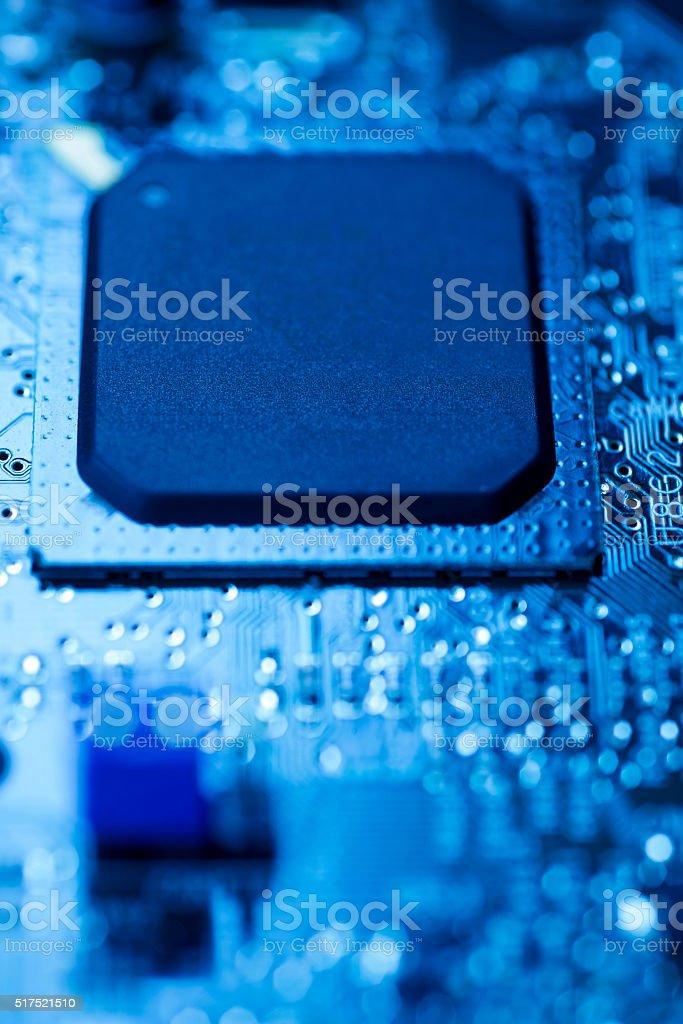 Microprocessor on blue circuit board stock photo