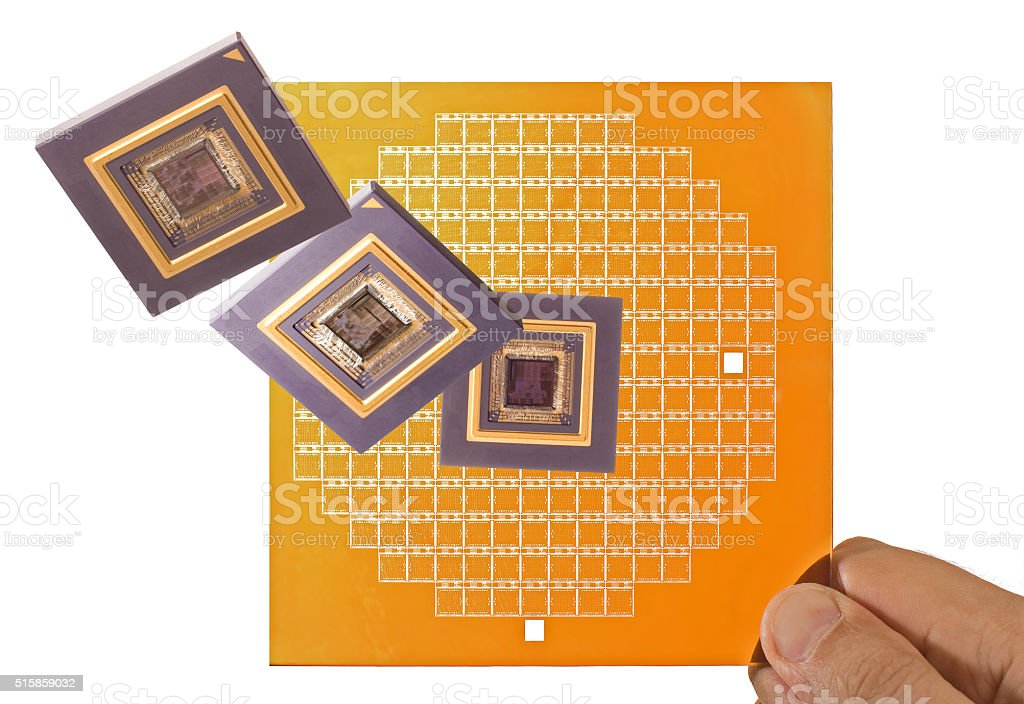 Microprocessors and chip mask in hand stock photo