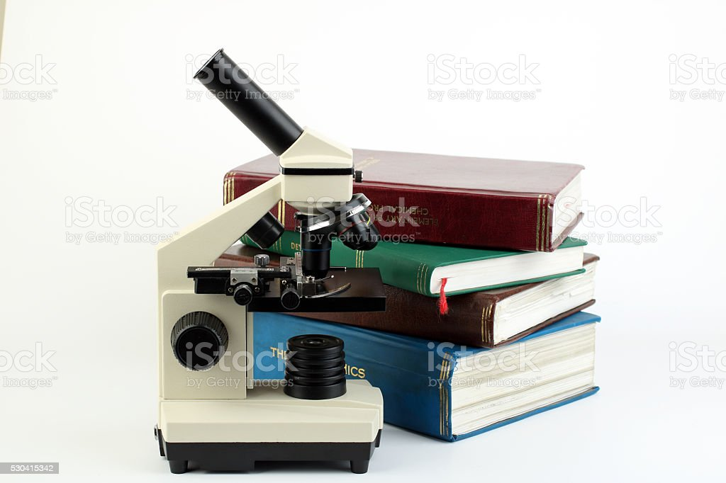 Microscope and books stock photo