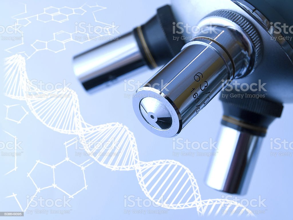 Microscope and DNA molecule. stock photo