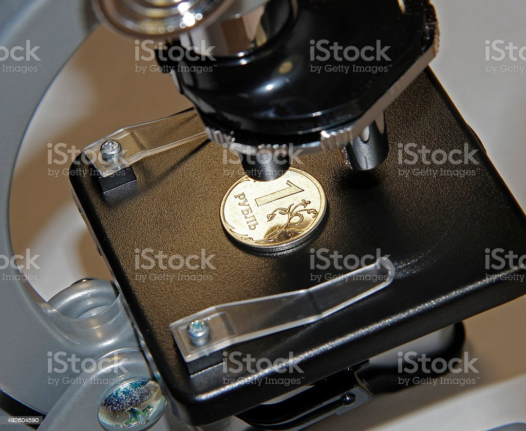 Microscope and money stock photo