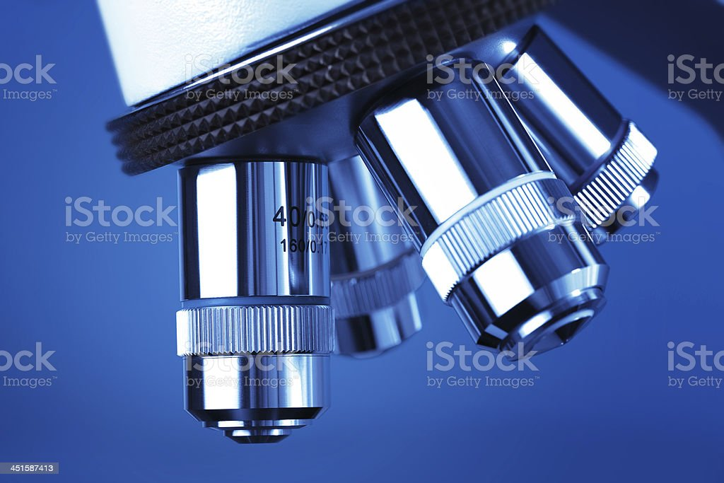 microscope detail against blue background royalty-free stock photo