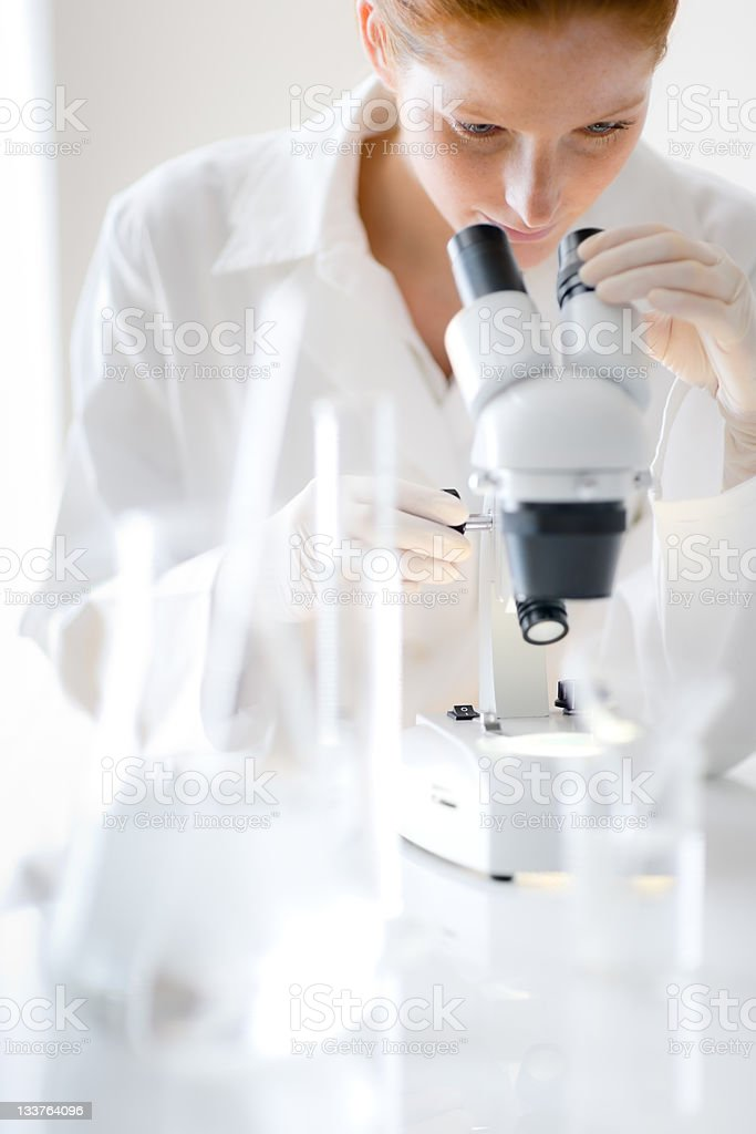 Microscope laboratory - woman medical research royalty-free stock photo