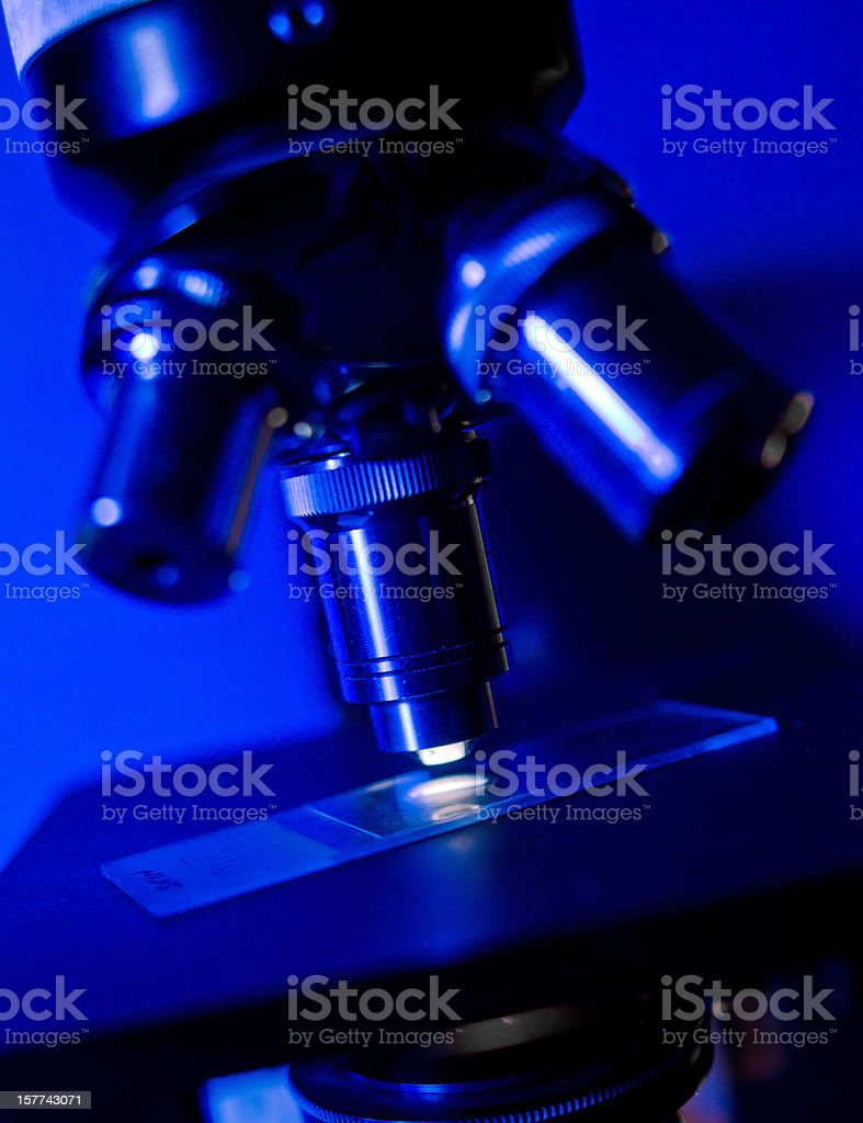 Microscope Lens on Blue Background royalty-free stock photo