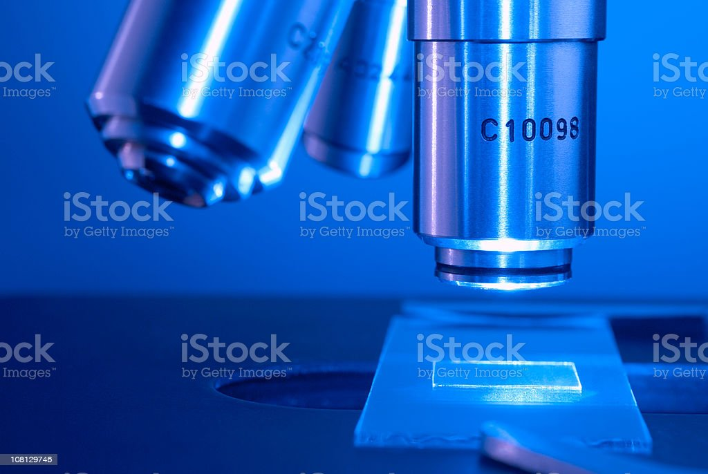 Microscope lens with slide stock photo