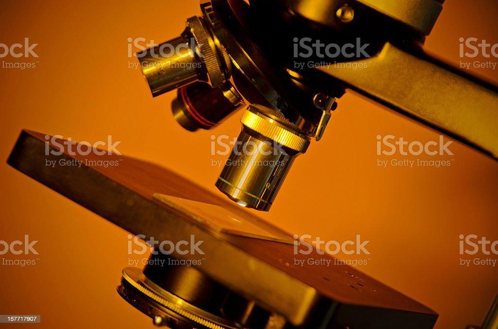 Microscope on Orange Background royalty-free stock photo
