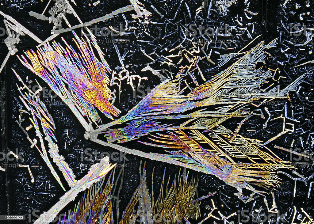 Microscopic view of potassium nitrate crystals in polarized light royalty-free stock photo