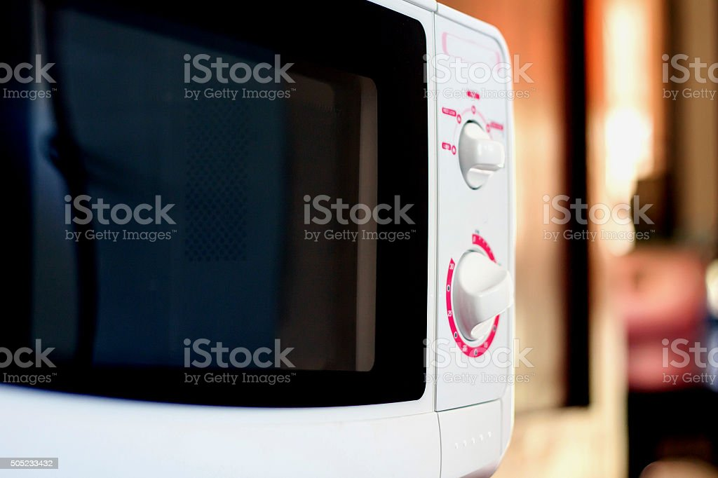 Microwave in kitchen stock photo