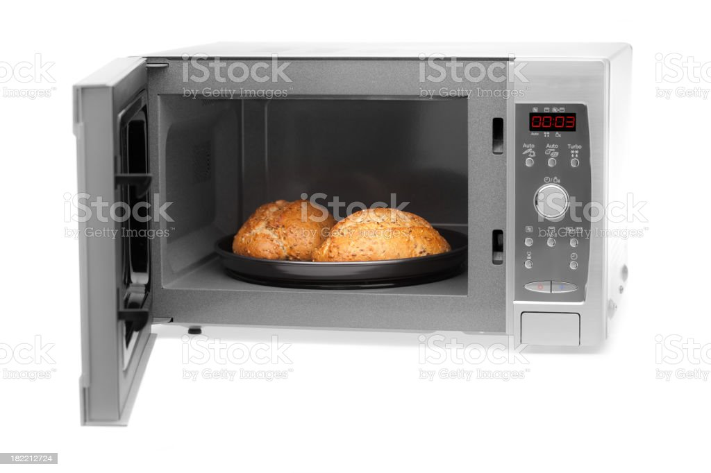 microwave on white with bread rolls royalty-free stock photo
