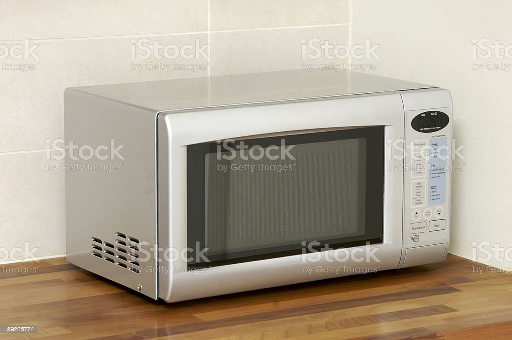 Microwave oven on kitchen worktop royalty-free stock photo