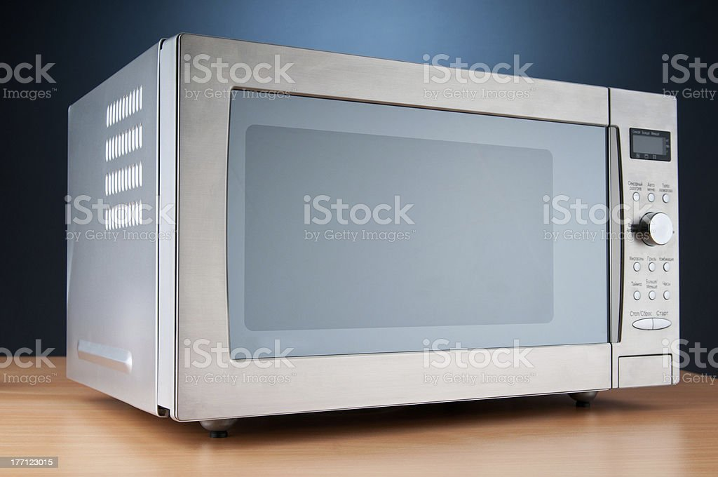 Microwave oven on the table stock photo