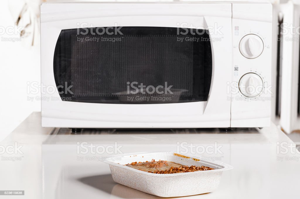 microwave oven with frozen food stock photo
