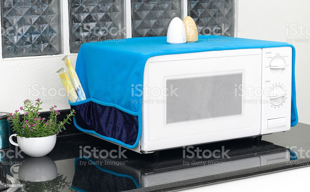 microwave oven with the cover blanket stock photo