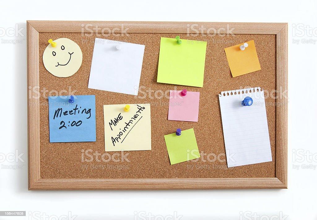 Mics Notes on Corkboard stock photo