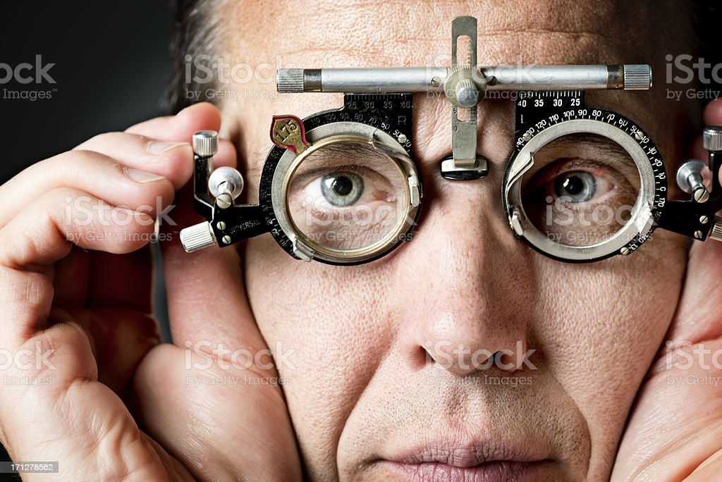 Mid 40's Man Having His Eyes Tested stock photo