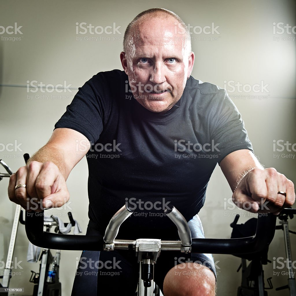 Mid 40's Man Taking a Spinning Class stock photo