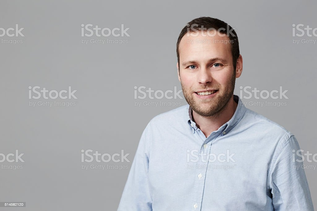 Mid adult bearded man in studio stock photo