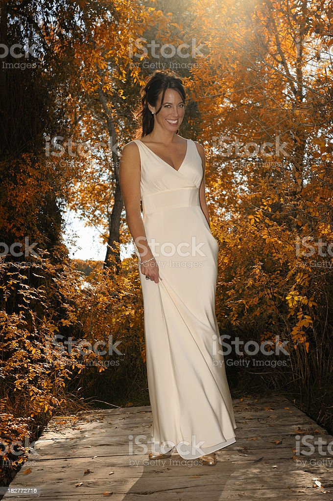 Mid Adult Bride Walking In Beautiful Fall Colors royalty-free stock photo