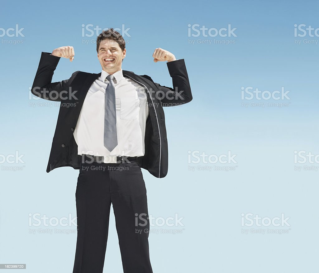 Mid adult  business man showing off his muscles royalty-free stock photo