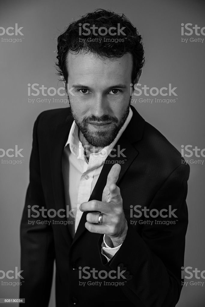 Mid adult businessman pointing at camera royalty-free stock photo