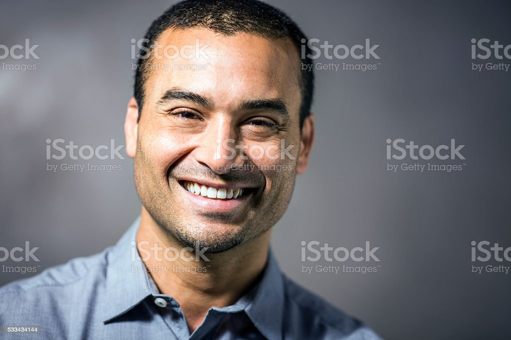 Mid adult businessman smiling outdoors stock photo